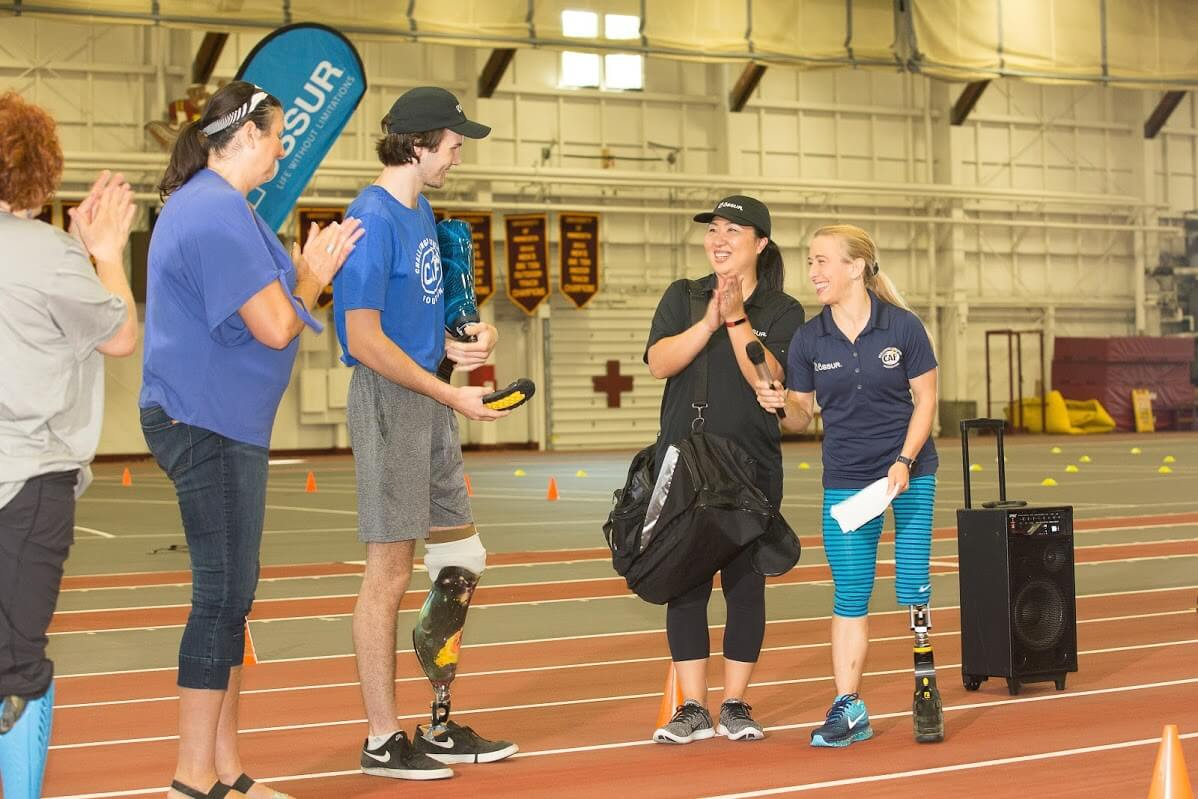 Tommy received his Össur Flex-Run before the clinic began. Sarah Reinertson, Team Össur, Nike ambassador and Paralympian, also attended. Click here to see more photos!